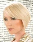 Blonde bob with a raised back and an angled cutting line towards the front