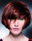 Modern short haircut with volume and diagonal styling