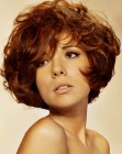 Liz Taylor look with short layered hair and large curls