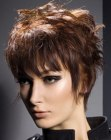 Short haircut with a graduated back that lengthens the neck