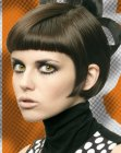 Mouth-length bob with curved lines and sleek styling