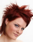Red hair in a short cut with top hair that is spiked up