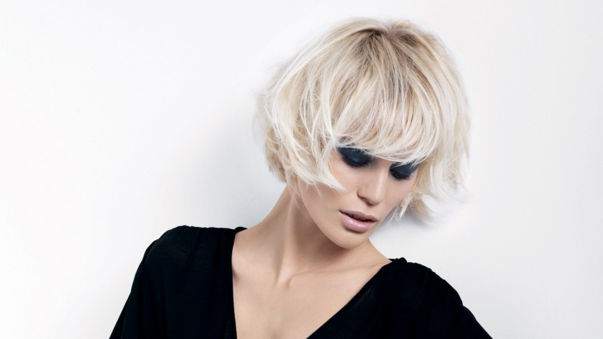 Short Bob With A Curved Fringe And Styling For A Bed Head