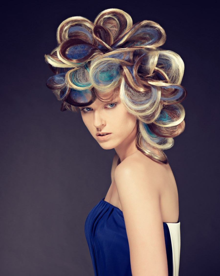 updo with loops of multicolored hair | blonde, blue and dark hues