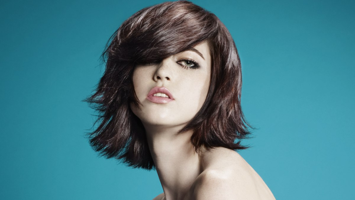 Tousled Bob With A Thick Fringe That Plunges Into The Face