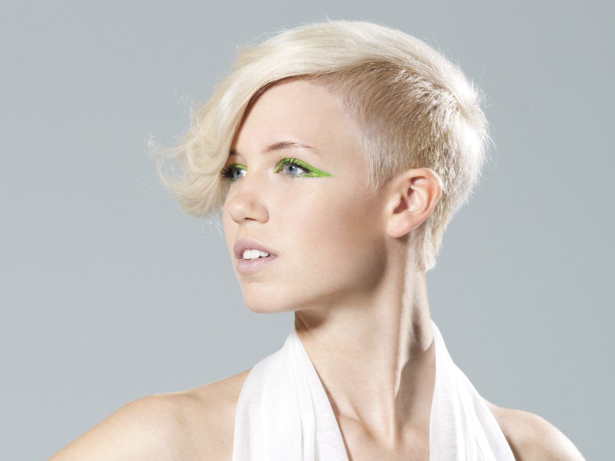 very short haircut with clipped sides and back and a hair tattoo