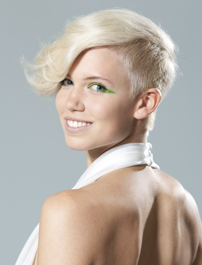 Very short haircut with clipped sides and back and a hair