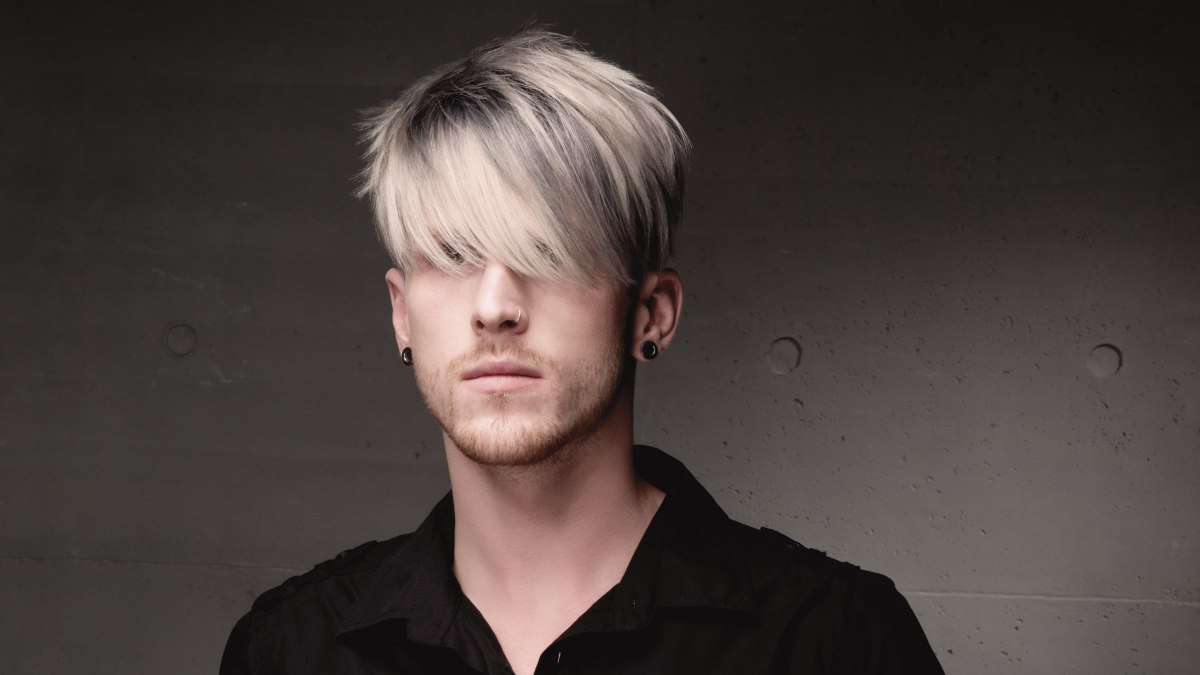 Men S Hairstyle With A Long Fringe And Streaks