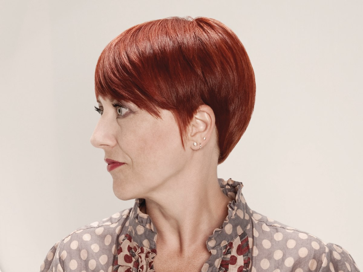 Red Hair Color And A Rounded Hairstyle For Older Women