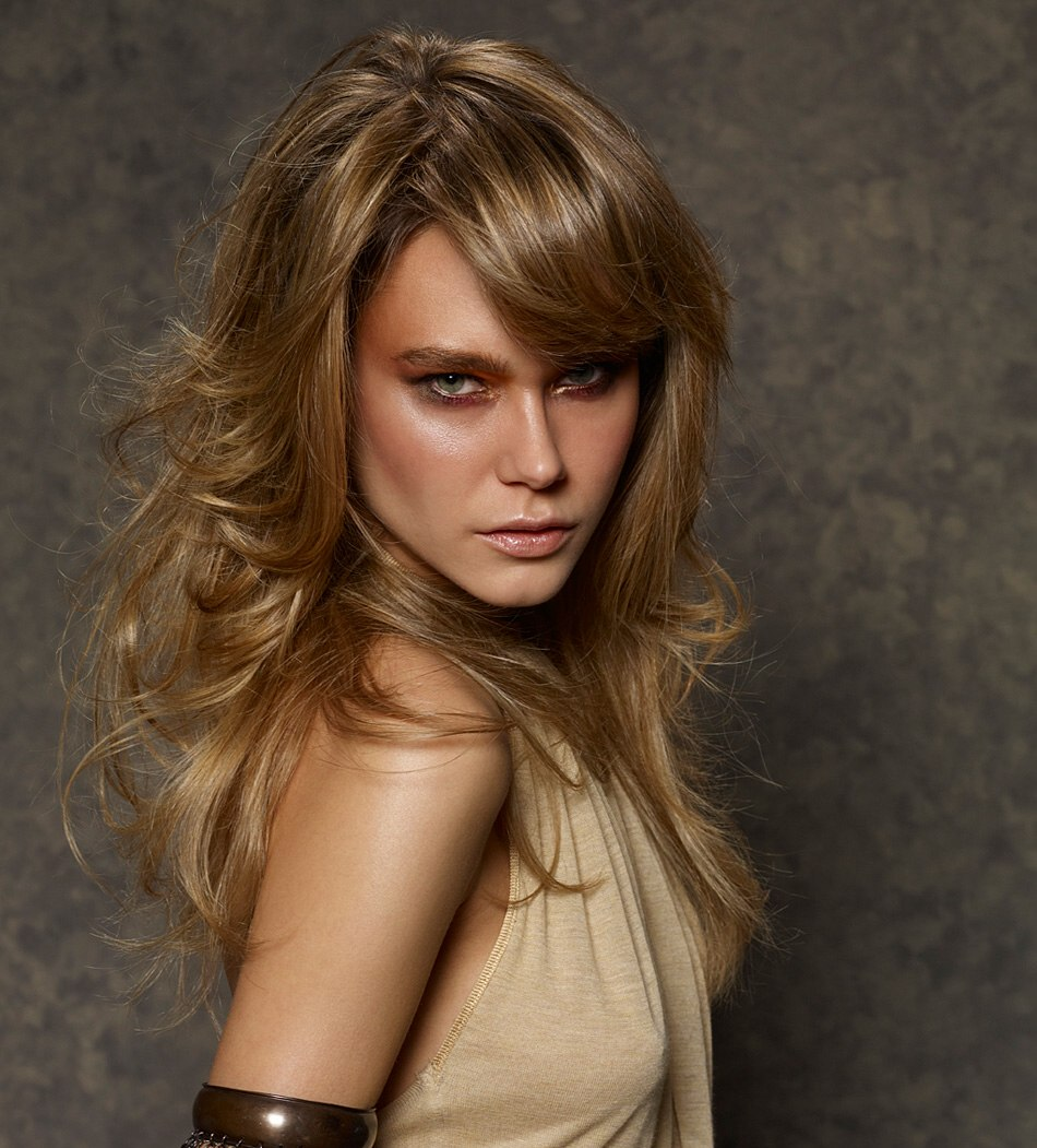 Sexy Long Hairstyle With Blonde Layers And A Side Fringe