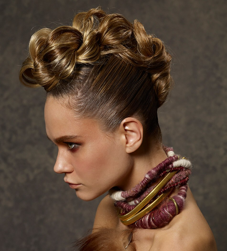 Up Style With A Loosely Woven Braid And Tightly Pulled Sides