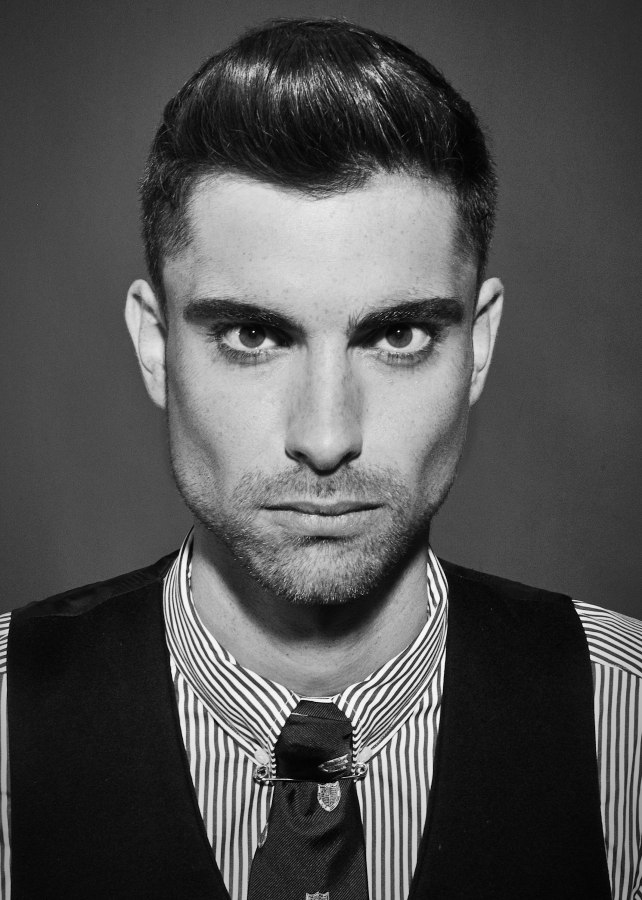 Short Men S Haircut With Clipped Sides That Transition Into A Stubble Beard