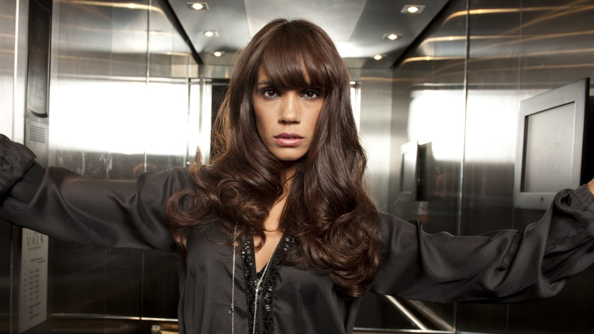 Mid Back Length Brunette Hairstyle Featuring Modern Bangs