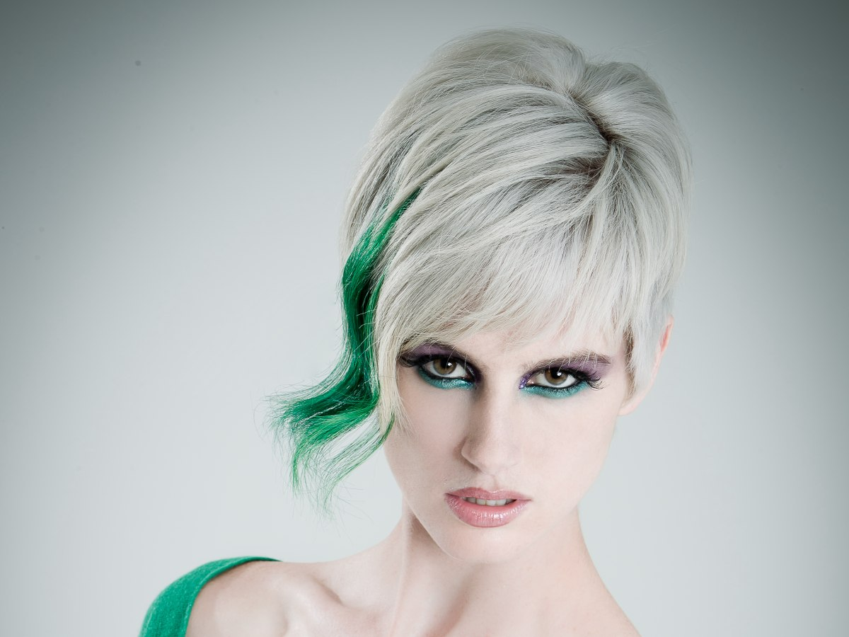 Short Haircut With A Silver Base Color And A Green Flash