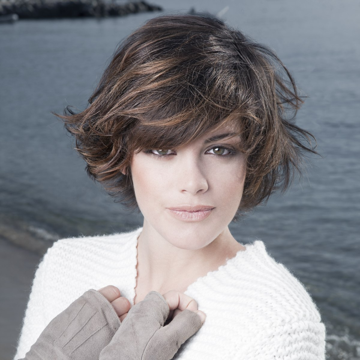 Short Layered Haircut With Movement And Bangs Curved