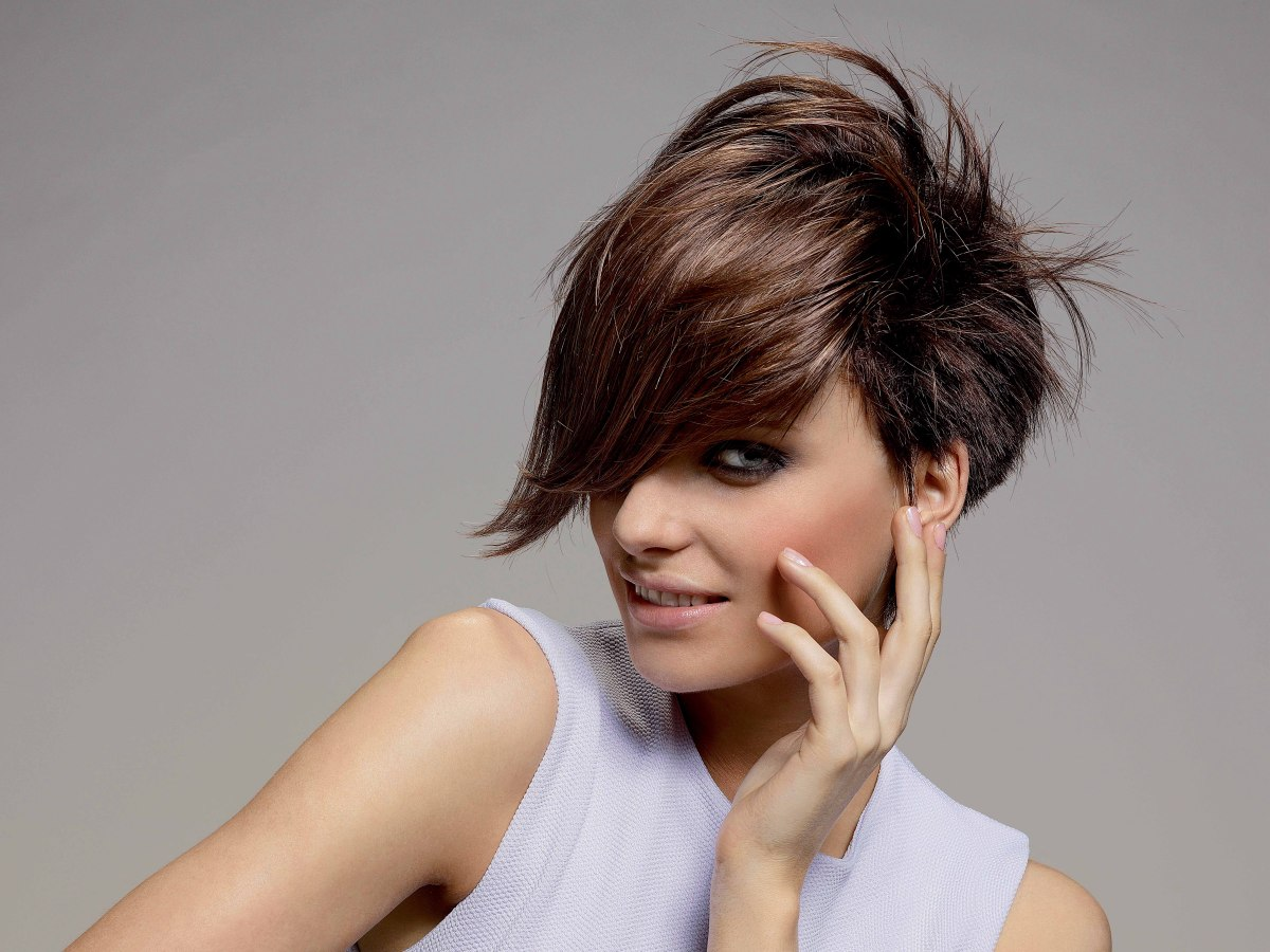 short hairstyle with two tone brown coloring and a long fringe