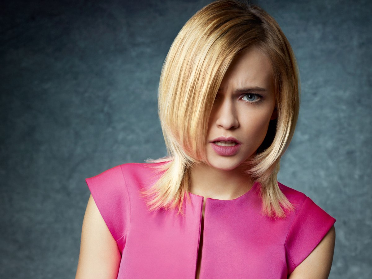 Chin Length Bob With A Feathered Extension Of Hair