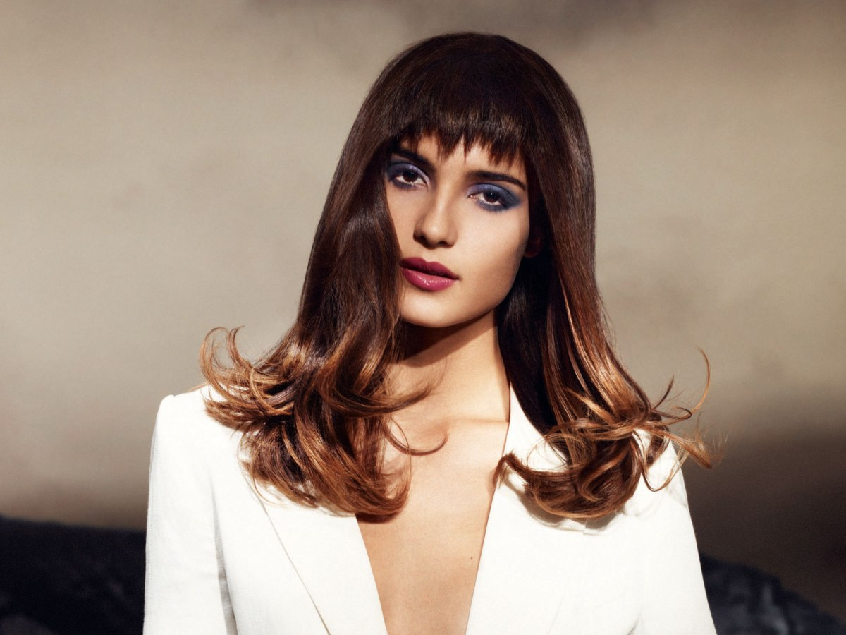 Long hairstyle with diagonal highlights and a modern ...