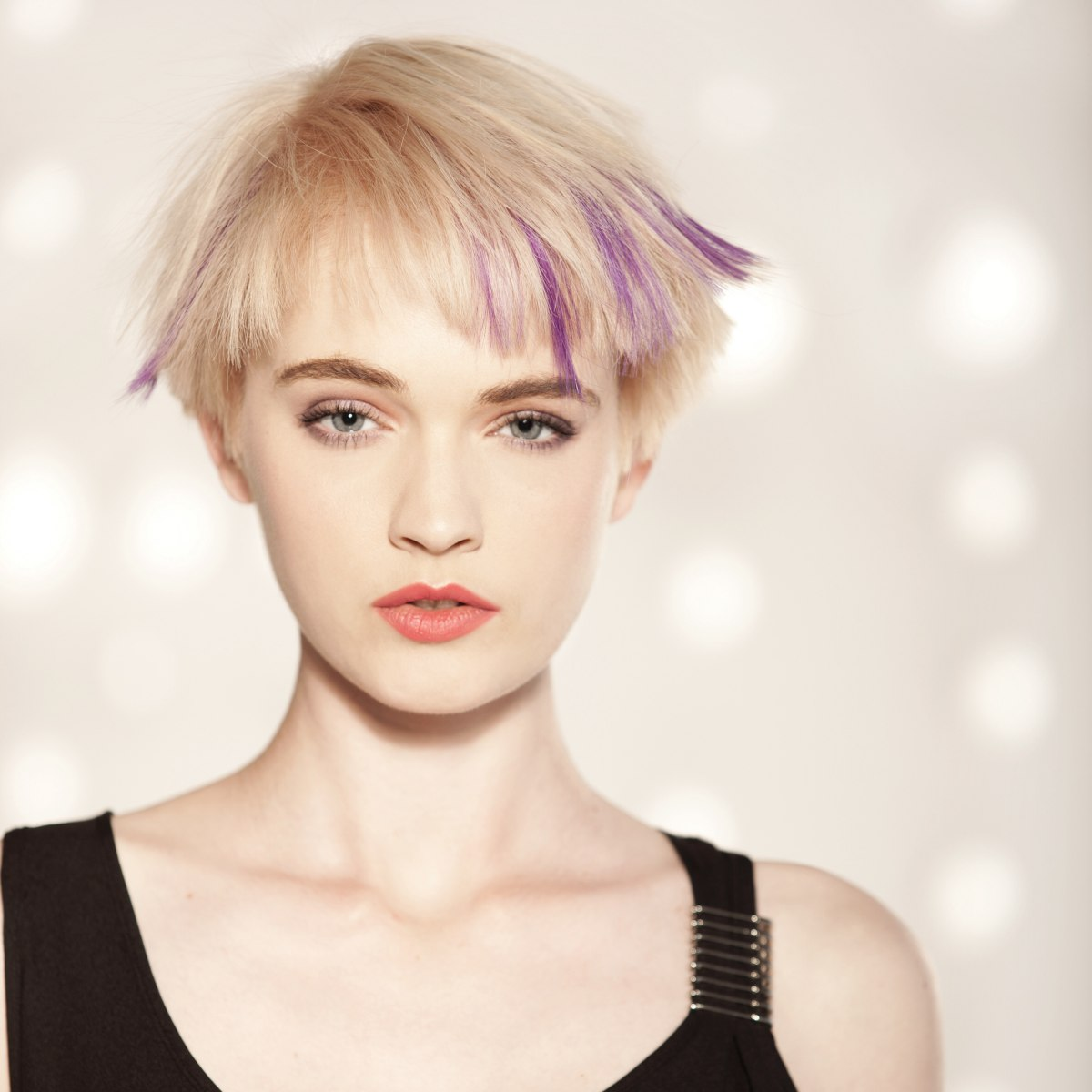 Short Haircut With A Jagged Texture And Purple Streaks