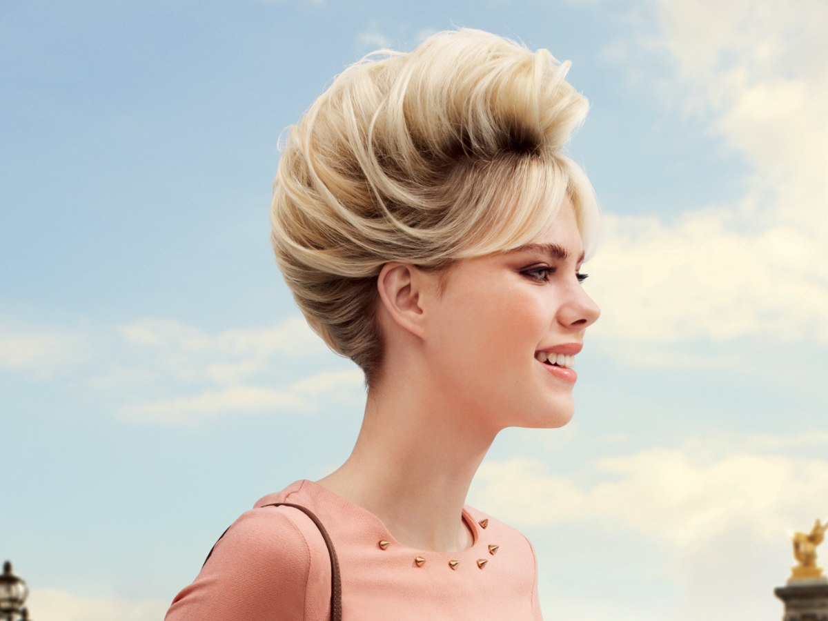 French twist upstyle with a side fringe and luxurious volume