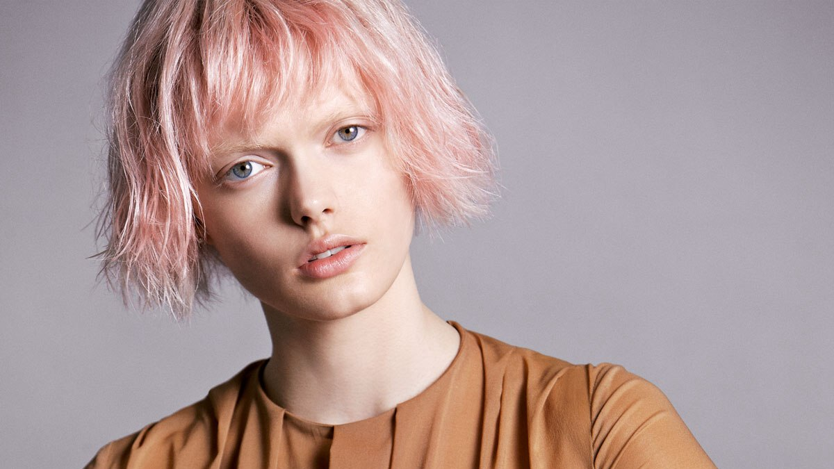 Short Pink Hair With A Fuzzy Cutting Line