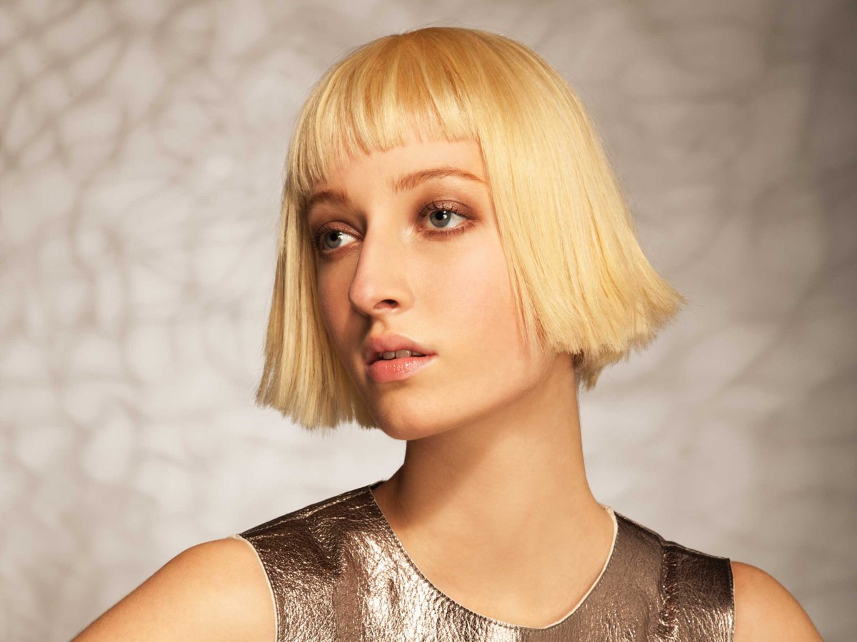 Very Modern Bob Cut With Sharp Lines And Slanted Bangs