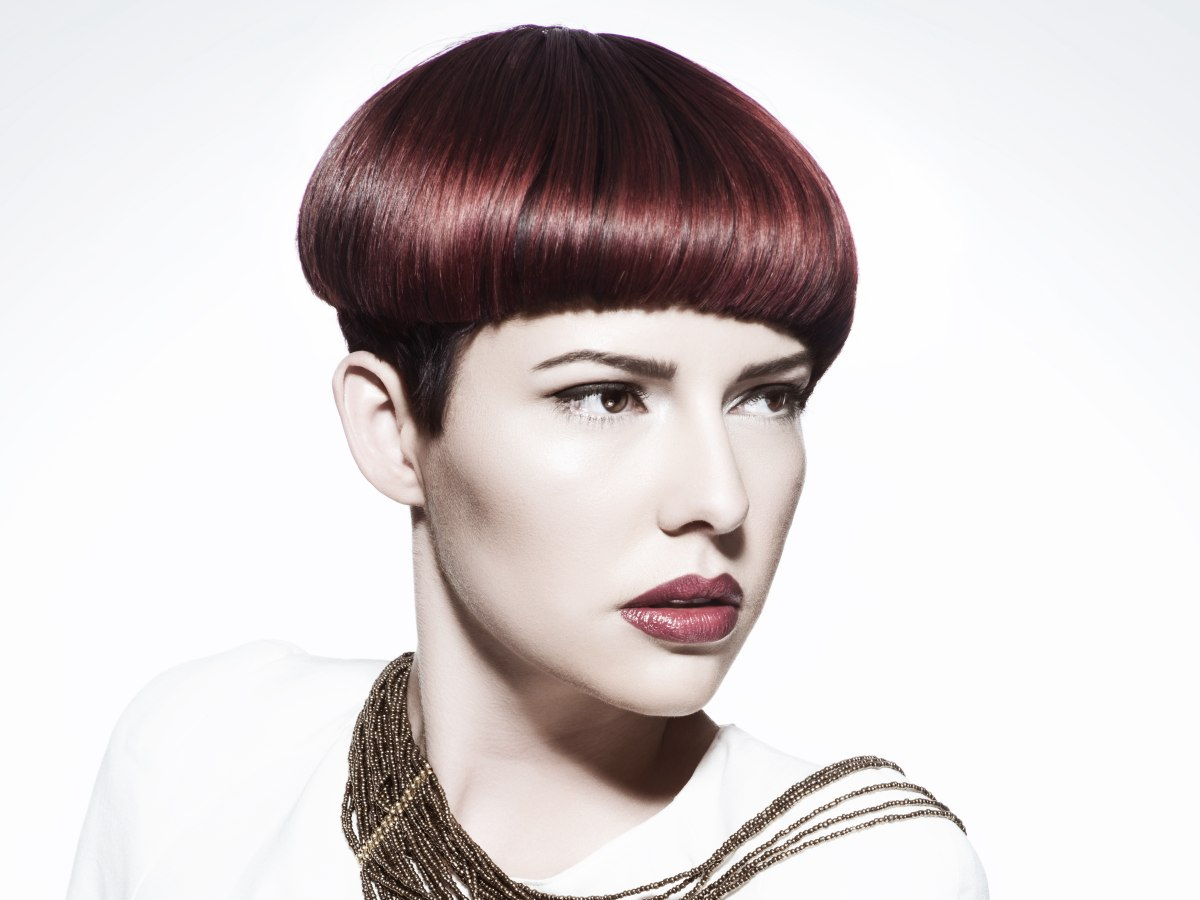 smooth short haircut with a retro mushroom shape and aubergine color