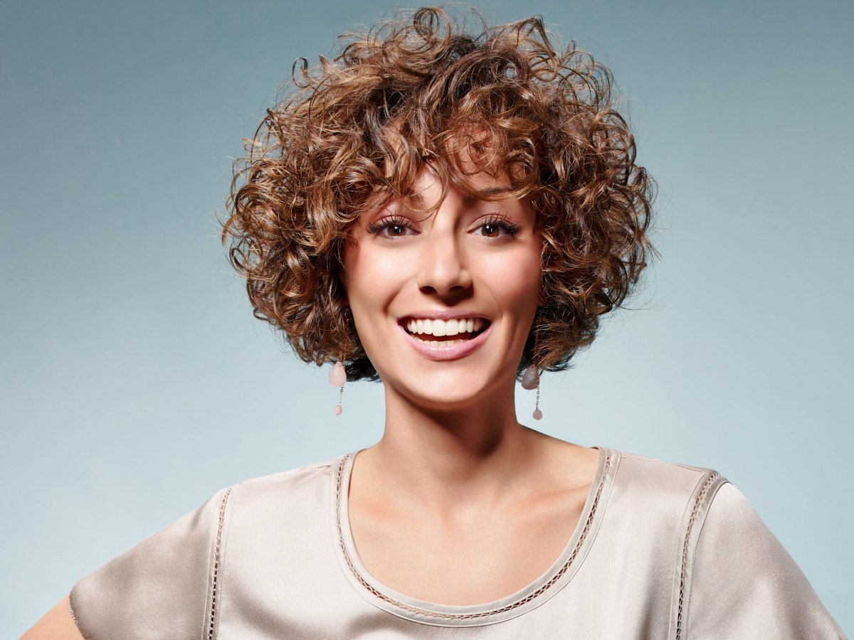Hair Style Of Death: Fresh Short Hairstyle With Happy Small Curls And A Round Shape