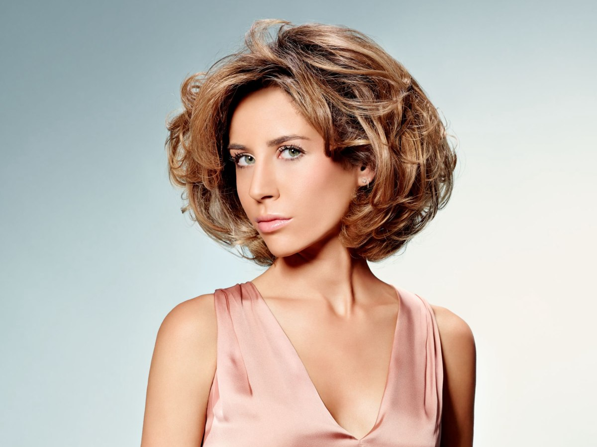 Short Layered Hairstyle With Volume, Movement And Body