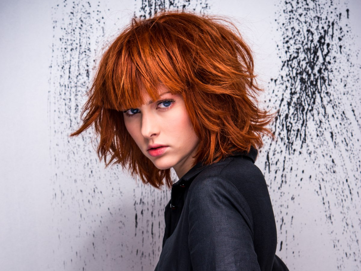 Red Hair In A Mid Length Bob With A Long Straight Fringe