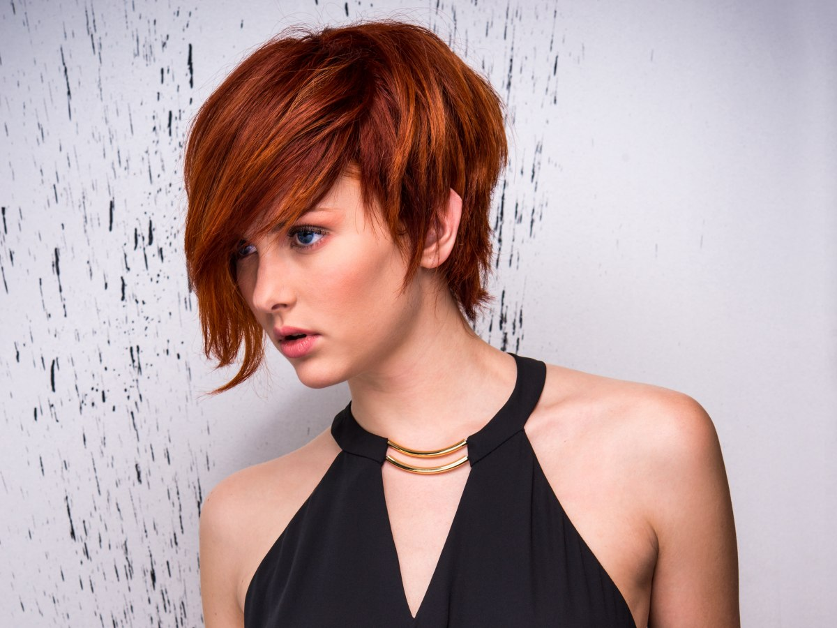 Boyish short cut with the long fringe styled to one side boyish short hair for girls winobraniefo Images