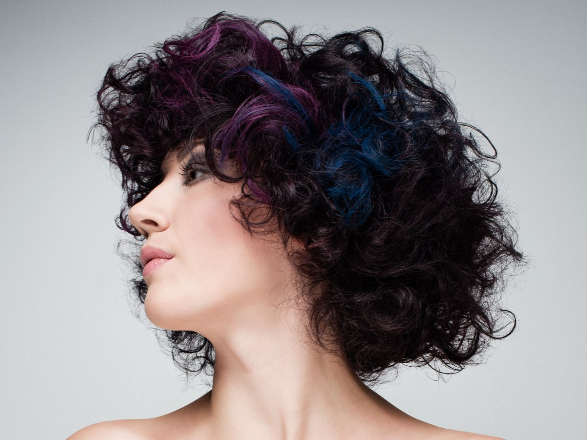 Black Hair With Curls And Streaks In Purple And Blue