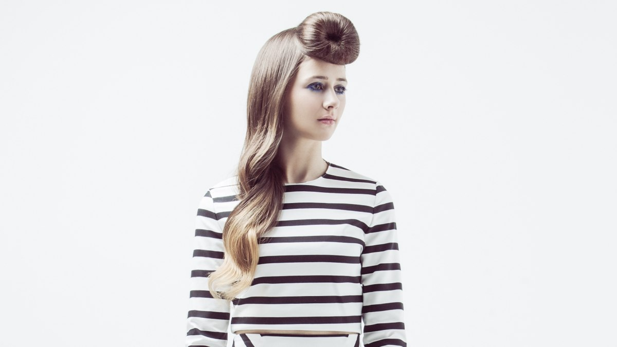 Long hairstyle with the fringe rolled into a bun above the forehead