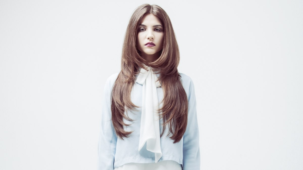 Long Hair With Curved Inward Ends That Reaches The Waist