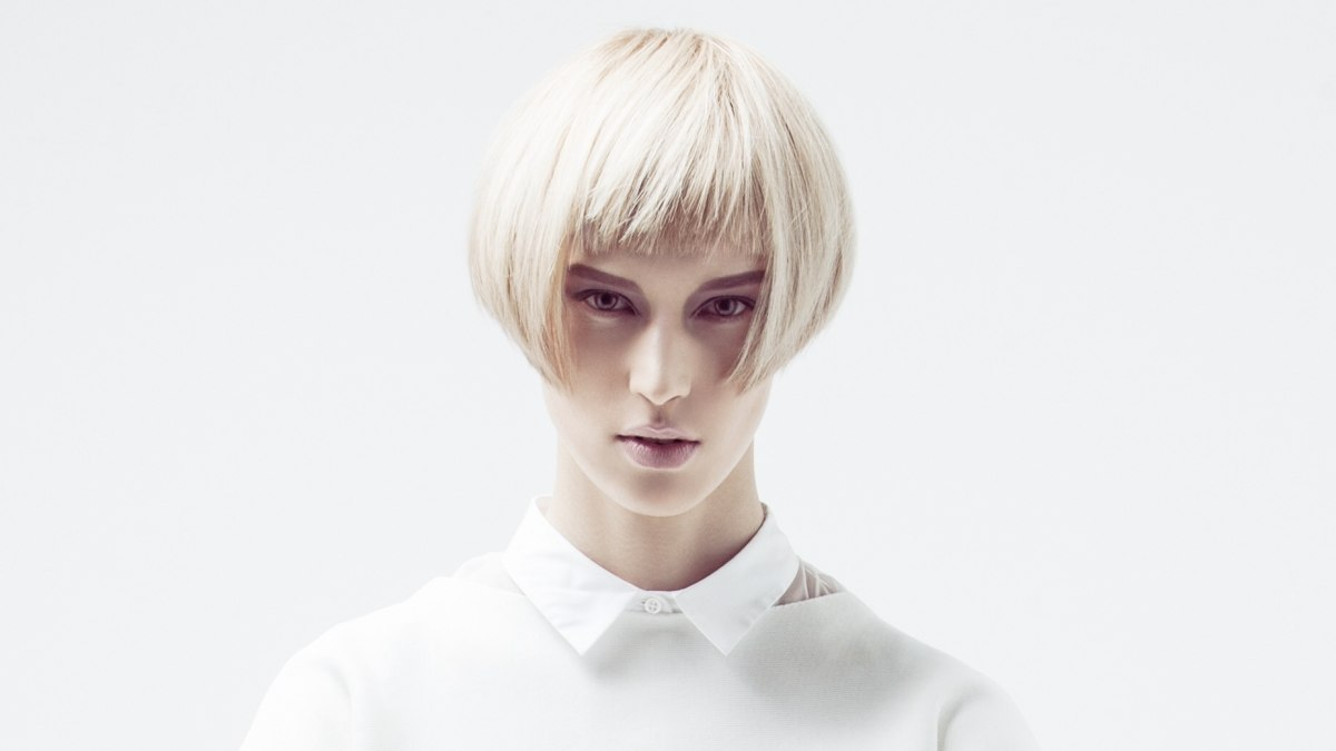 Modern short cut with a short fringe and an elongated neckline