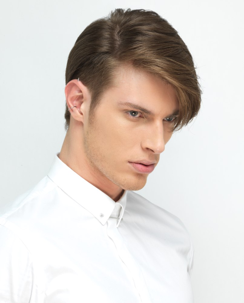 Classic men's haircut with a short undercut before the ear