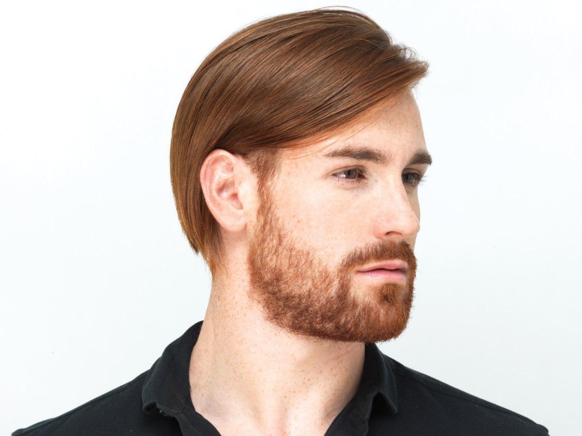 Sleek Men's Haircut With A Modern Attitude And A Beard