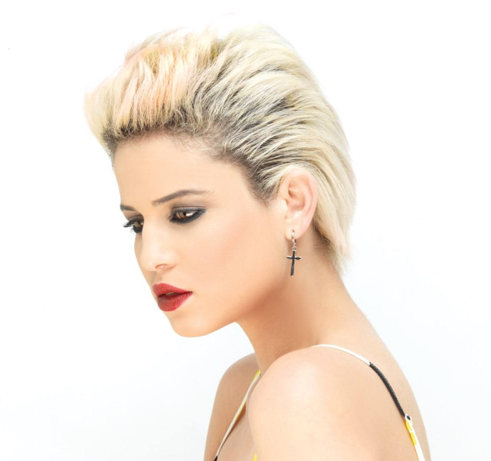 Radical short hairstyle with a silver hair color and dark