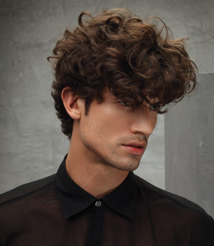 Men S Hairstyle With Latin Style Curls And A Low Sitting