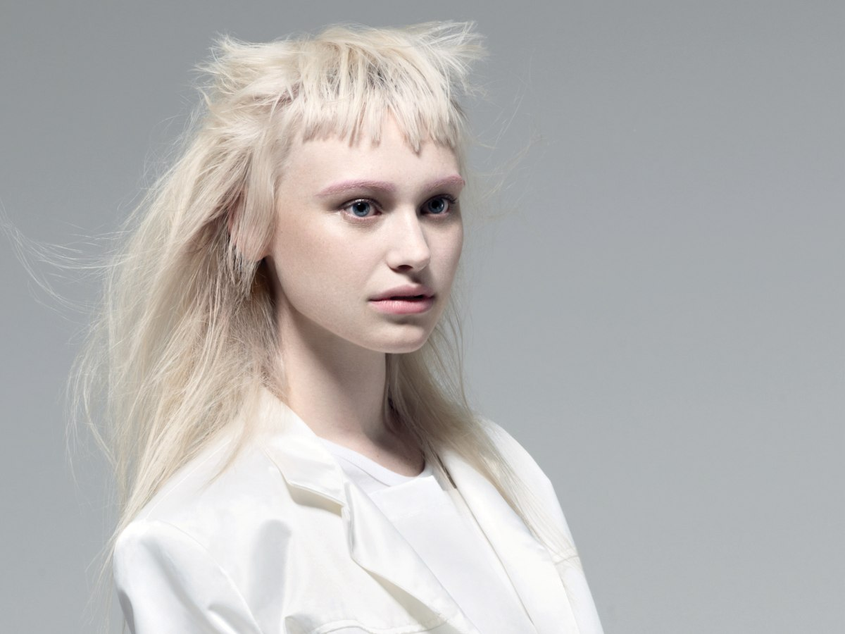 Long blonde hair with a jagged and flared out fringe