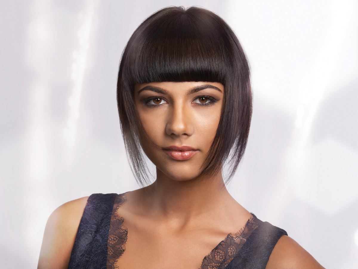Short Light And Feathery Hair With A Bold Fringe