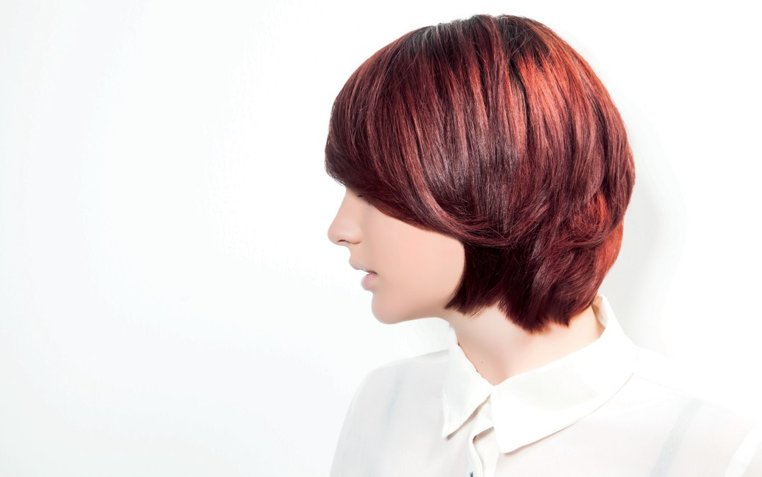 Short Collar Length Hairstyle With A Long Side Fringe