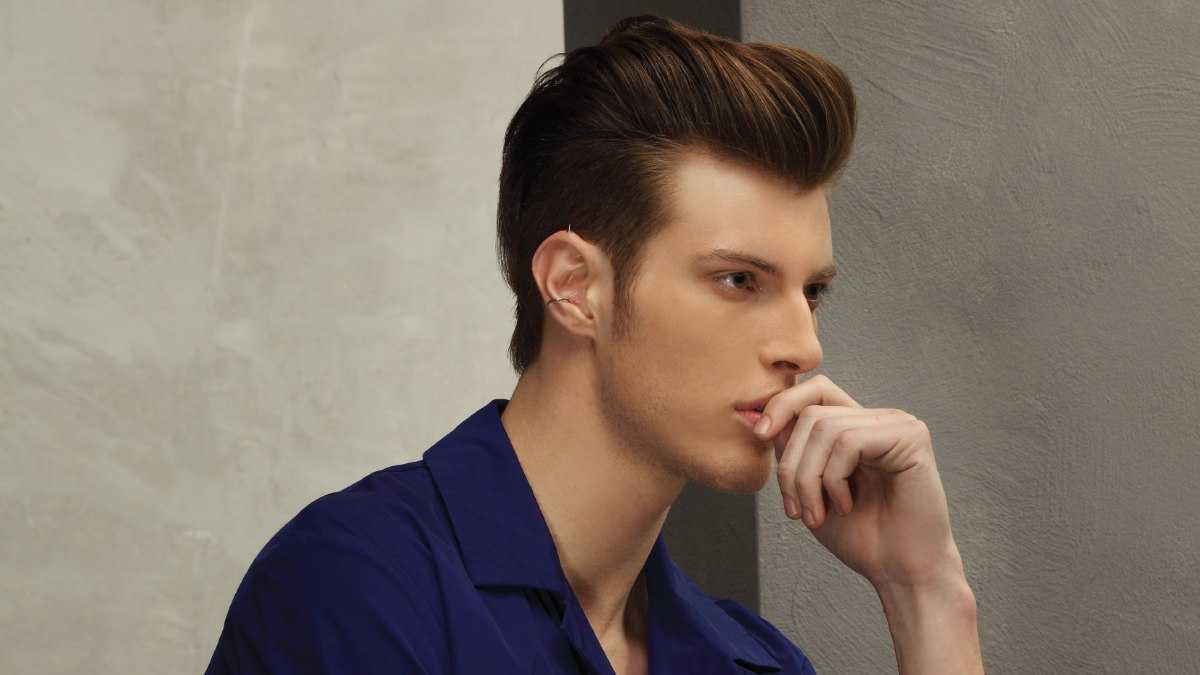 Side view of a men's haircut with undercutting