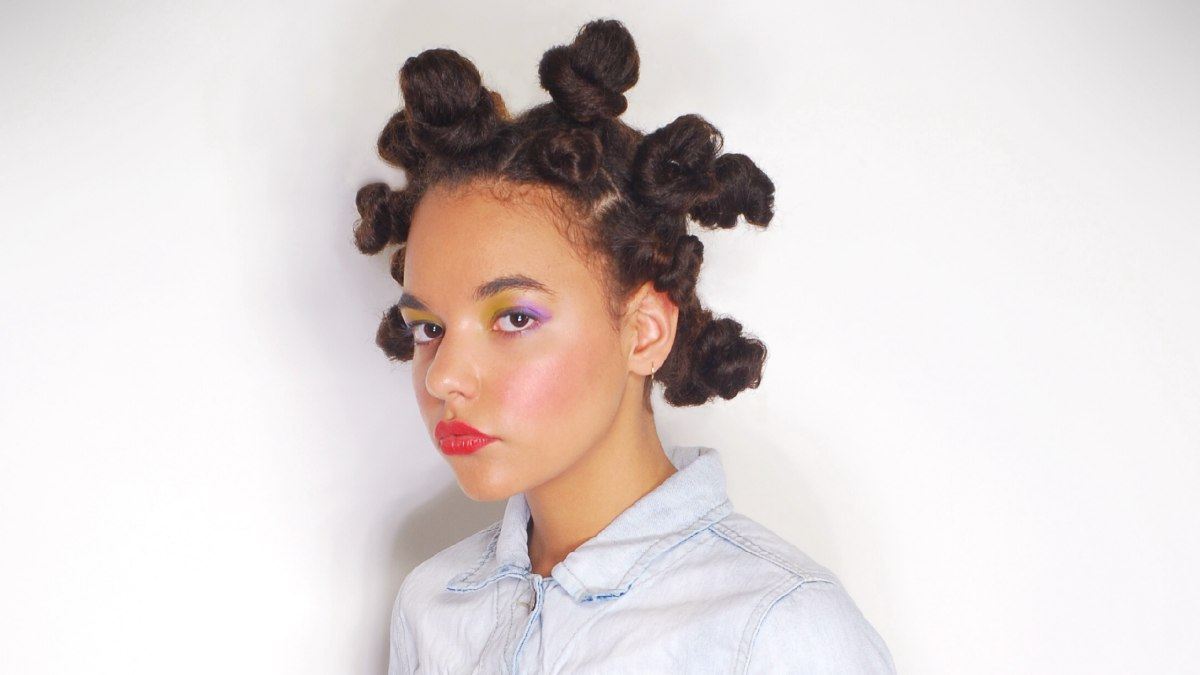Long kinky hair twirled and twisted into tight knots