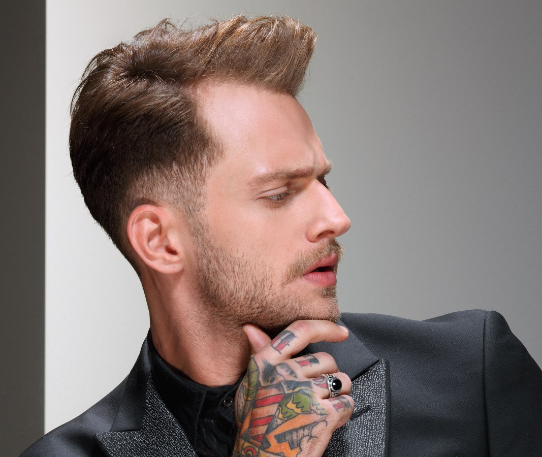 fashionable mens hairstyle with a small quiff and an undercut