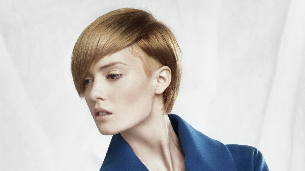 Short haircut with a radical undershave, sleek top hair and diagonal ...