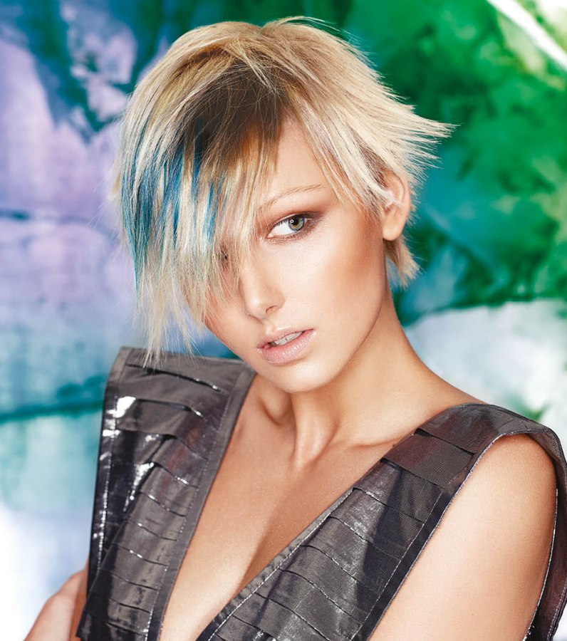 Short platinum blonde hair with blue layers