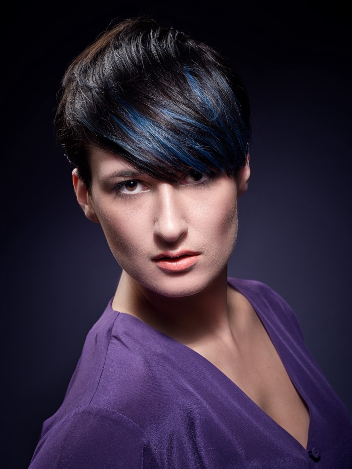Slick Short And Shiny Black Hair With A Bright Blue Line