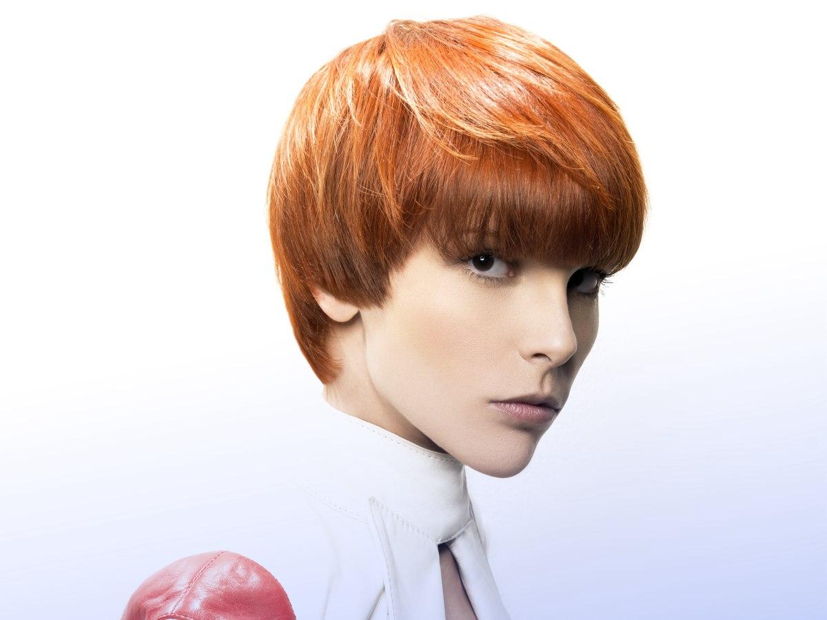Feminine And Short Just Above The Earlobe Haircut Redhead