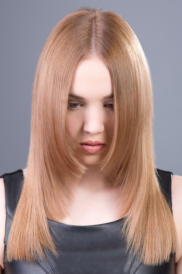 Straight Long Hair With A Centerpart And Tapered Sides